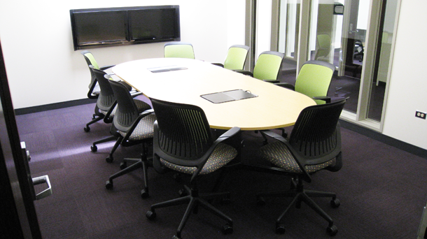 Conference table and dual monitors