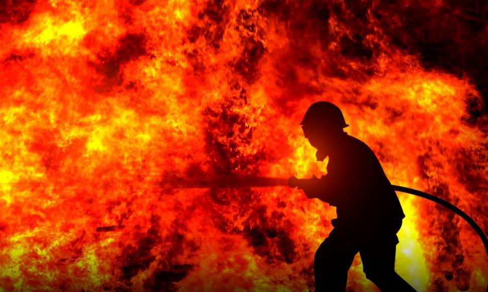firefighter-fighting-a-raging-wildfire--silhouette.jpg